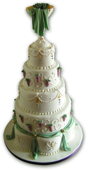 Giant white, purple and green wedding cake