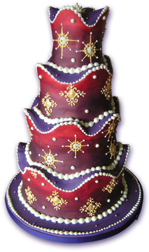 Red and purple wedding cake with gold and pearl mediaeval decorations